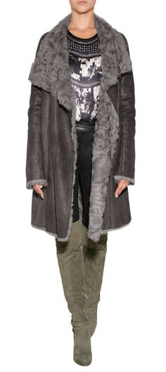 Detailed in a patchwork of luxurious grey shearling, this stand-up collar coat from Yves Salomon is a sleek choice for taking through the cooler months #Stylebop