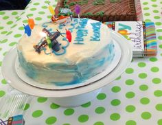 It was a neutral theme with bright colors, but I did personalize my sons cake with 2 planes from the movie Planes and some star candles. Simple white cream cheese icing to go with the carrot cake. Piped blue clouds and happy birthday!