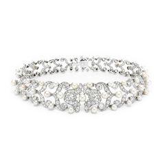 A Belle Epoque Natural Pearl and Diamond Choker Necklace, circa 1905