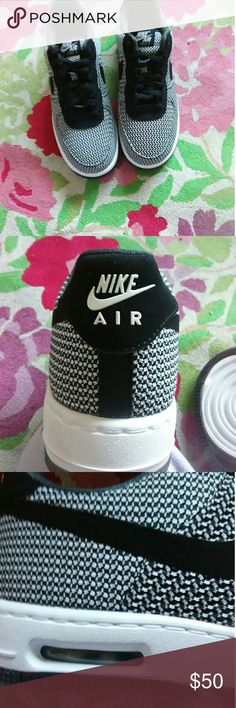 FRESH Black & White Nike air force shoes NEW! Never worn.  Nike's perfect style in Black and white. Has the Nike logo sitting sleekly above the heels. Bottoms are unworn can even see all the stars at your feet. These are a DEAL!    Size 8 womens. Lowtop Price is firm! Nike Shoes Sneakers