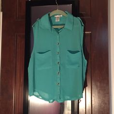 teal sleeveless button down blouse never worn; a little see-through but super cute! large but fits like a small A'GACI Tops Button Down Shirts
