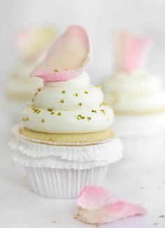 Vanilla rosewater cupcakes with candied rose petal topper. So sweet and adorable!