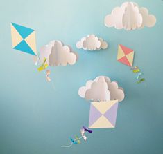 Made of card stock, the clouds and kites are light enough to be moved by even a gentle breeze. Description from etsy.com. I searched for this on bing.com/images