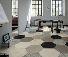 Hexagon shaped carpet tiles are an excellent choice of flooring for commercial or residential settings. Here is gives the room a studio or loft style look. Carpet tiles available at Express Flooring in Phoenix, Arizona.