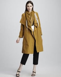Cascade-Collar Trenchcoat No closet is complete without this staple. Get a more updated look with details like studs, a cool silhouette, or in a color other than classic beige.