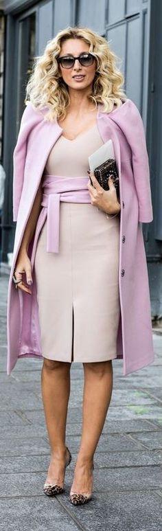 Pink coat over a beige dress.
