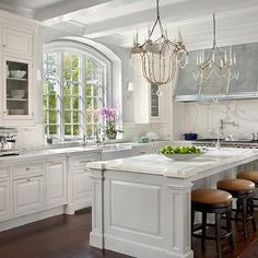 Magnificent white design kitchen with more amenities then I can list by O'Brien Harris - kitchens