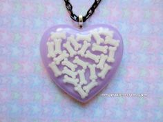 Pastel Creepy Cute Bone Heart Necklace by NerdyLittleSecrets, $12.00