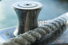 hawser: Hawser with cleat Sailing Pictures, Stock Photos