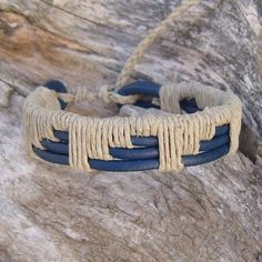 Four strands of blue 3mm leather cord woven with natural hemp cord. This Woven Blue Leather and Natural Hemp Bracelet is adjustable, fits 6.5-8.5 inch wrist and is 27mm wide.