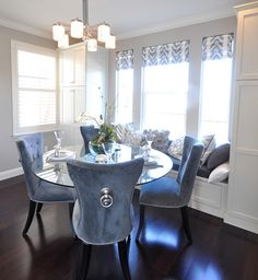 Dining room with blue velvet chairs and window bench. Glass Dining Table, Velvet Dining Chairs, Blue Velvet Chairs, Dinning Room Decor, Home Decor, Tufted Dining Chairs, Dining Room Decor, Dining Room Table, Dining Chairs