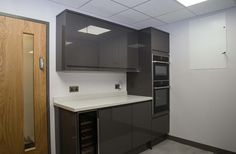 Compact office kitchen design by JBH Refurbishments