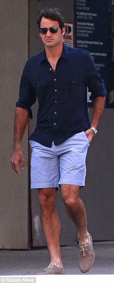 navy shirt with pale blue shorts and suede beige shoes