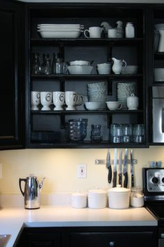 i like the black open cabinets