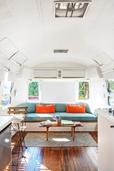 Cute Airstream camper van with wood floors and teal accents Renovation Design, Airstream Renovation, Airstream Interior, Vintage Airstream, Vintage Campers, Vintage Trailers, Airstream Living, Airstream Remodel, Airstream Trailers