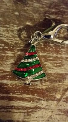 Christmas Tree Lobster Claw Charm from Dusti's Doggy Wear. This can be clipped onto your dogs collar. How cute! The little rhinestones that decorate the tree are so pretty. #scottsmarketplace