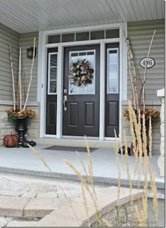 Setting for Four: Fall Home Tour {2013}, love the chocolate brown door with white trim and greige siding