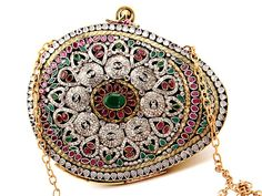 Miraculous clutch #Purse made of golden brass metal studded with multicolor stones. Item Code: SJBP2026 http://www.bharatplaza.com/new-arrivals/accessories.html