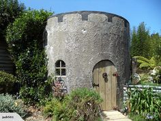 Concrete water tank converted into a play castle. Fun! (Interior pic at link)