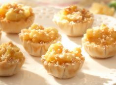 Apple Tartlets - Flaky phyllo cups are filled with a combination of Granny Smith apples, cinnamon and butter, then sprinkled with crushed shortbread cookies. Mini Desserts, Just Desserts, Delicious Desserts, Dessert Recipes, Yummy Food, Phyllo Recipes, Cooking Recipes, Apple Tartlets Recipe, Phyllo Cups
