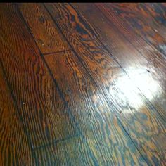 $50 floor. I tore out the carpet, sanded and stained the plywood subfloor, used a sharpie pen for the lines and rolled over that with a pizza cutter. : )