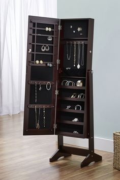 I have one of these and it was honestly the best decision I've made for jewelry organization. My jewelry used to be a mess and now its perfectly organized and I also have a full length mirror on the other side too! $159 http://hautelook.hardpin.com/tracker/c.php?m=HardPin&u=type359&cid=1894&hscpid=1636532&url=https%253A%252F%252Fwww.hautelook.com%253Fsid%253D545570%2526mid%253Dsocialmedia%2526cid%253Dhellosoci9%2526aid%253Dtype359