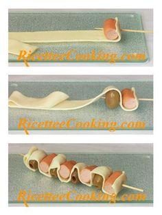 Spiedini di pasta sfoglia wurstel e olive: procedimento
