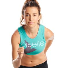Race day ready crop top. Flattering high neckline is perfect for pinning bib numbers. Sublimated Oiselle Volée logo on front and back. Same fit and design as our Elite Racing Singlet, the Volée 3/4 bra is ready to race! - 87% poly