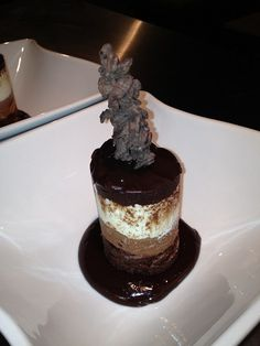 truffle type cake, a layer of dark chocolate mousse, then a layer of white chocolate mousse and topped with a chocolate almond glaze and served in a hot chocolate anise glaze.