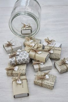 Small Christmas presents in a mason jar. For decoration or as an Advent calendar with sweets inside.