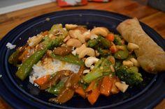 Slow Cooker Cashew Chicken - 1 can Golden Mushroom soup, 3 Tbs soy sauce, 1 tsp ground ginger, 1 & 1/2 # chicken tenders, 16 oz pkg frozen oriental stir-fry mix, 4 oz can sliced mushrooms, 1/2 C cashews & rice.