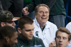 Tom Izzo watches the Big Ten Championship game from the sidelines with the rest of the basketball team Dec. 7, 2013, at Lucas Oil Stadium in Indianapolis, Ind. The Spartans defeated the Buckeyes, 34-24. Danyelle Morrow/The State News