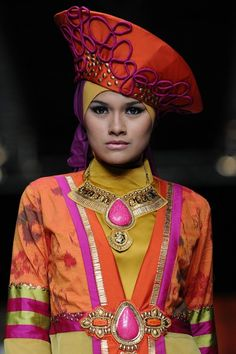 A model showcases designs by Lia Afif on the runway at the Cymaversa Queen  show during Jakarta Fashion Week 2014 at Senayan City on October 22, 2013 in Jakarta, Indonesia.