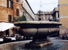 La Fontana del Campo de' Fiori. A lidless copy of the original is again in the Campo de' Fiori, but now on the northeast end of the square, and at a higher elevation.