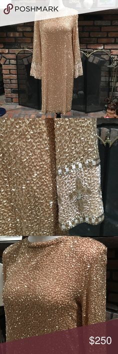 Bob Mackie Boutique Beaded Gown size 12 Bob Mackie Boutique Beaded Gown size 12.  Gorgeous gold beaded dress.  Plunging back.  Shoulder pads.  100%silk with beading.  Some loose beads, but majority in tact.  One small spot on right wrist.  Not easily seen.  Also small spot on front below left side of bust.  Hard to see with all the beading.  This is a head turning stunner in all the rage gold.  Truly beautiful!!37 inches long from shoulder to hem. 19 inches pit to pit. Bob Mackie Dresses