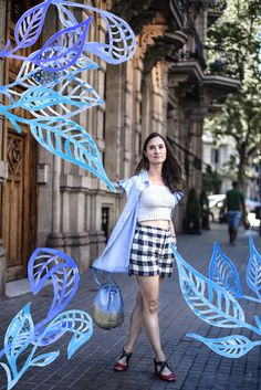 Art and fashion with gingham shorts and pleats street style look.