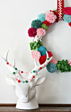 Gorgeous pom pom wreath; you can even make it with your kids!