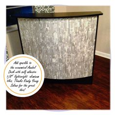 Adding Sparkle to the Anabel Reception Desk! Lowes & Home Depot have a great selection of thin & lightweight aluminum tiles. Randy Young used a mat that has adhesive on both sides. Unroll it on the surface & then peel off the film leaving an adhesive for the tile. It can then be grouted immediately, cutting the project down! Randy also recommends using a premixed acrylic grout. It won't chip out from between the tile. Thanks for the great idea Randy Young Salons!