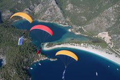 Enjoy breathtaking tandem Oludeniz paragliding flight with experienced pilot. Babadag mountain Fethiye paragliding in Olu Deniz Turkey. Most Beautiful Beaches, Beautiful Places, Portal, Pamukkale, Seaside Beach, Tourist Information, Adventure Activities, Paragliding, Travel Agency