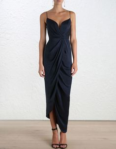 Sueded Silk Plunge Long Dress, from our Spring 16 collection, in French Navy sueded silk. Draped detail through bodice and skirt. Fully boned bodice with wired plunge neckline and shoestring straps. Asymmetric draped skirt. Centre back zip closure, fully lined.