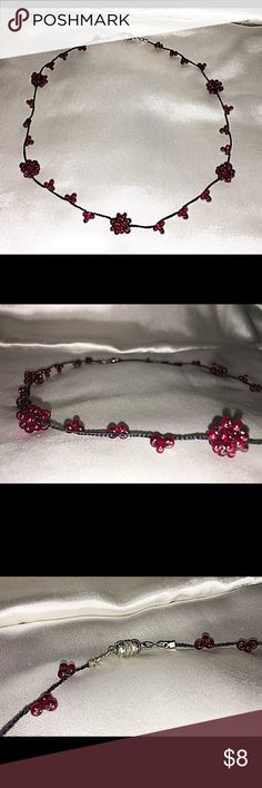 Deep Red Beaded Necklace with Magnetic Closure This is a collar-bone length cluster-beaded necklace with a magnetic closure. Jewelry Necklaces