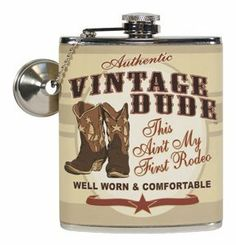 """Vintage Dude Western Cowboy """"This Ain't My First Rodeo"""" Hip Flask Gift by Oak Patch. $20.49. 7 ounces; Measures 3 3/4"""" x 4 1/2."""". """"This Ain't My First Rodeo"""". Includes funnel and attachment chain for easy filling. Printed faux leather design. Stainless steel hip flask with humorous vintage dude western rodeo message. Honor him for the sport he loves by giving him our Vintage Dude Rodeo flask. Ensure the man in your life knows he is well appreciated.   This stainl..."""