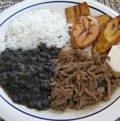 Typical Venezuelan Christmas plate called Pabellon-black beans, shredded beef, rice, and fried plantains. Yummy!