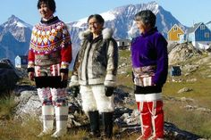people of greenland. The colour of the kamiks (skin boots) did traditionally show the womans marital status: the white is unmarried. The red is married. The black is widowed. But otherwise this middle dress is just modern