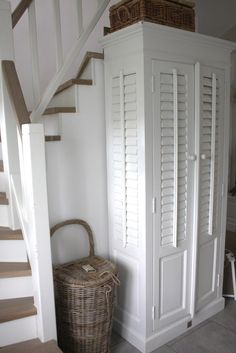 Hallway; shutters and rattan - lovely combination. (Diy Storage Cupboard)