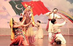 Islamabad May 13 : Pakistani artists performing during the cultural show in honor of the visiting 100 Member Chinese Youth Delegation at PNCA.