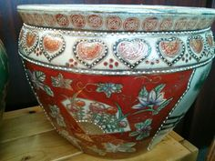 This lovely painted pot is $64, a great deal and beautiful addition to the home