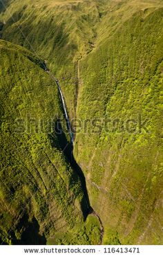 Kahiwa falls picture taken from helicopter, Molokai island, Hawaii by UgputuLf SS, via ShutterStock