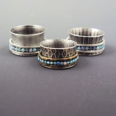 This week I finished a trio of 'spinner' rings that feature patterned silver wide-band rings with a fun 'spinner' band on the outside that ...