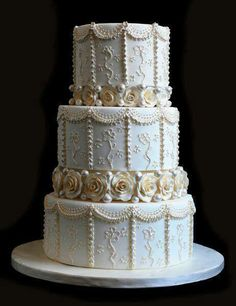 use tier separators and cover them with roses so it looks like the cake is standing on the roses!